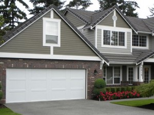 grey house with white garage door